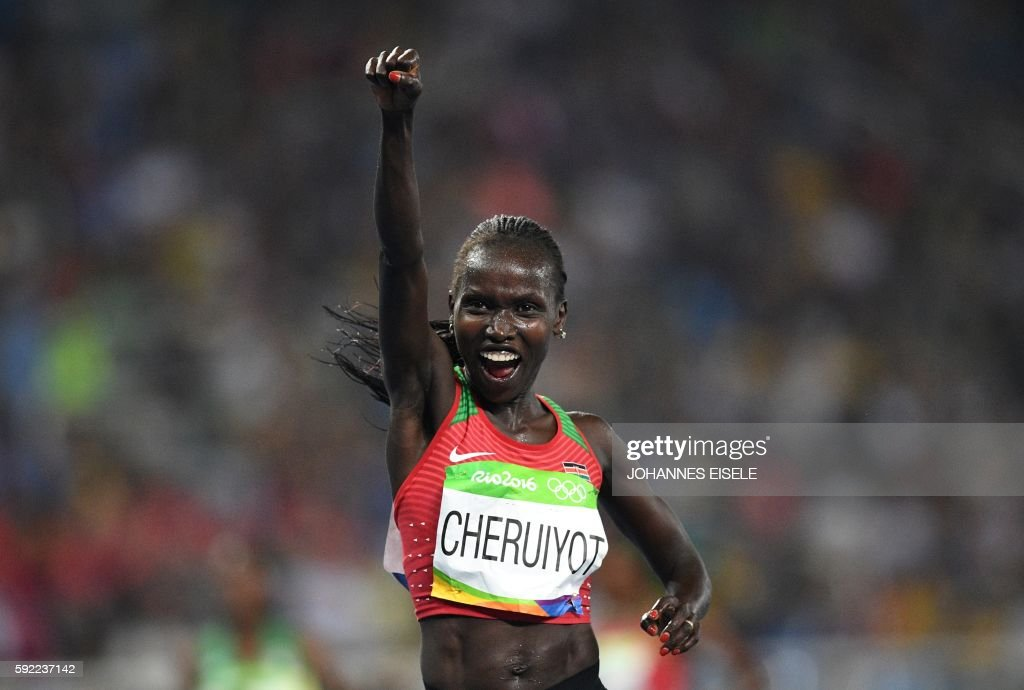 TOPSHOT - Kenya's Vivian Jepkemoi Cheruiyot celebrates her victory in the Women's 5000m Final during the athletics event at the Rio 2016 Olympic Games at the Olympic Stadium in Rio de Janeiro on August 19, 2016. / AFP PHOTO / Johannes EISELE