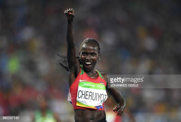 Kenya's Vivian Jepkemoi Cheruiyot celebrates her victory in the Women's 5000m Final during the athletics event at the Rio 2016 Olympic Games at the...