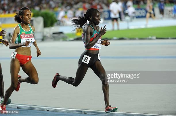 Kenya's Vivian Jepkemoi Cheruiyot leads Ethiopia's Meseret Defar during the women's 5000 metres final at the International Association of Athletics...