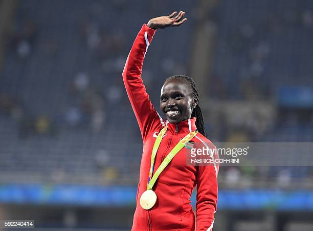Kenya's Vivian Jepkemoi Cheruiyot poses during the podium ceremony for the Women's 5000m during the athletics event at the Rio 2016 Olympic Games at...