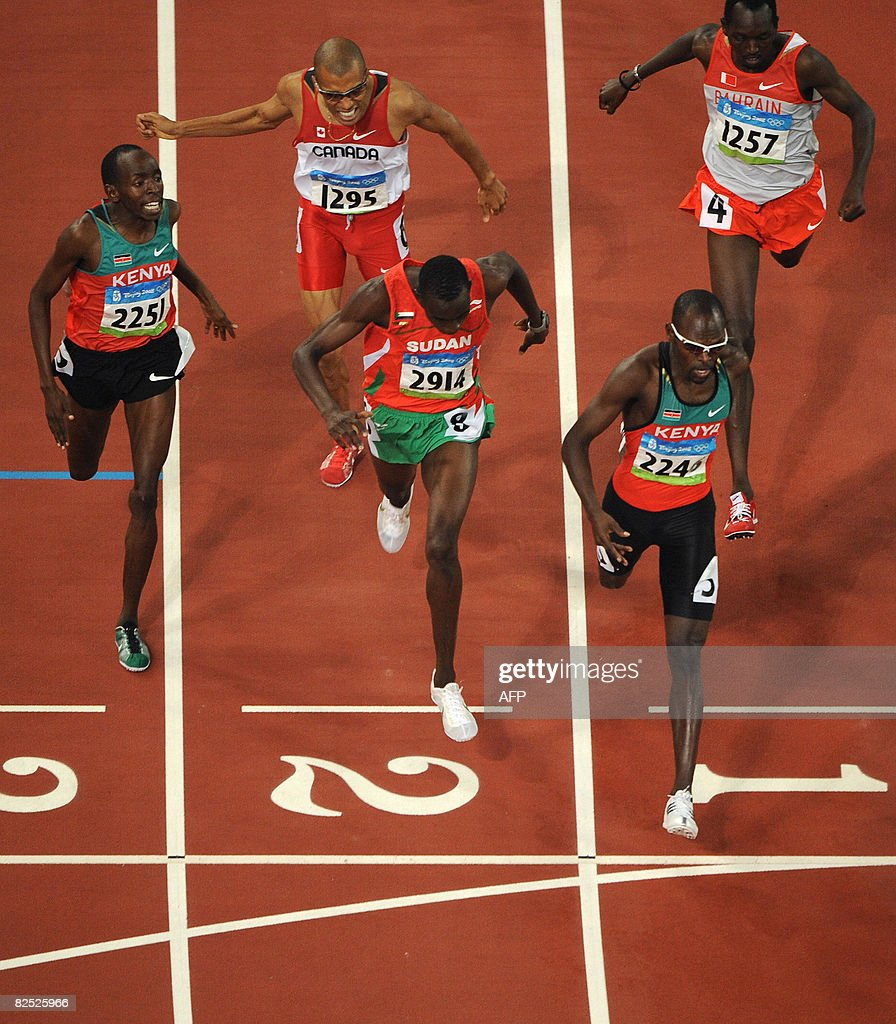 Kenya's Wilfred Kipkemboi Bungei (R) crosses the finish line ahead of Sudan's Ismail Ahmed Ismail (C) and Kenya's Alfred Kirwa Yego to win the men's 800m final at the National stadium as part of the 2008 Beijing Olympic Games on August 23, 2008. Kenya's Wilfred Kipkemboi Bungei won gold ahead of Sudan's Ismail Ahmed Ismail and fellow countryman Alfred Kirwa Yego.