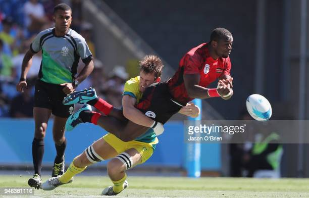 Kenya's Willie Ambaka throws a pass against Australia during Rugby Sevens on day 11 of the Gold Coast 2018 Commonwealth Games at Robina Stadium on...