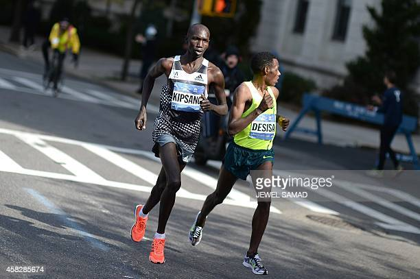 Kenya's Wilson Kipsang and Ethiopia's Lelisa Desisa run in the New York City Marathon on November 2 2014 Kipsang won the New York City Marathon men's...