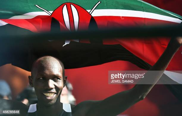 Kenya's Wilson Kipsang celebrates at the finish line of the New York City Marathon on November 2 2014 Kipsang won the New York City Marathon men's...