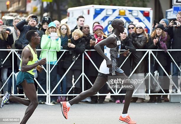 Kenya's Wilson Kipsang runs past Ethiopia's Lelisa Desisa to win the New York City Marathon on November 2 2014 Kipsang won the New York City Marathon...