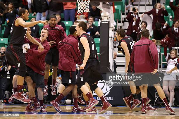 Kenyatta Smith of the Harvard Crimson and his teammates celebrate the 68-62 victory against the New Mexico Lobos during the second round of the 2013...