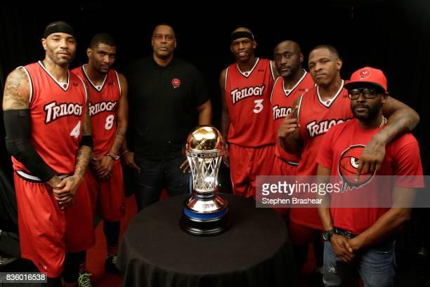 Kenyon Martin James White head coach Rick Mahorn Al Harrington Dion Glover Rashad McCants and assistant coach DeMarcus Bateman of the Trilogy pose...