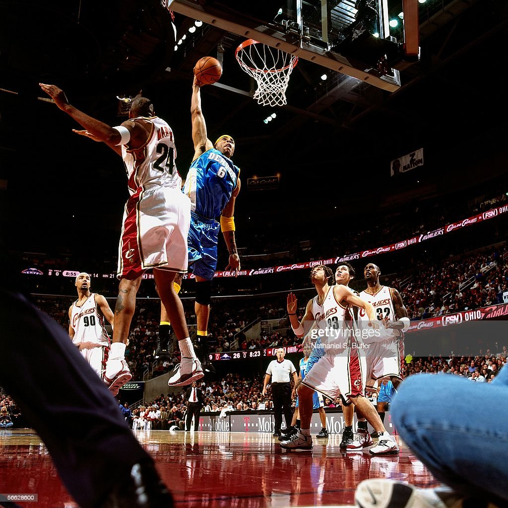 Kenyon Martin #6 of the Denver Nuggets dunks against Donyell Marshall #24 of the Cleveland Cavaliers on December 15, 2005 at Quicken Loans Arena in Cleveland, Ohio.