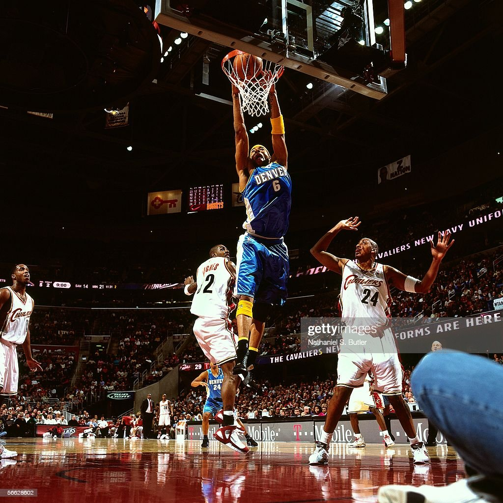 Kenyon Martin #6 of the Denver Nuggets dunks against Larry Hughes #32 and Donyell Marshall #24 of the Cleveland Cavaliers on December 15, 2005 at Quicken Loans Arena in Cleveland, Ohio.