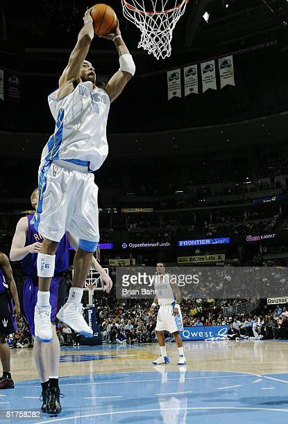 Kenyon Martin of the Denver Nuggets dunks against the Toronto Raptors in the second half of NBA action on November 17 2004 at the Pepsi Center in...