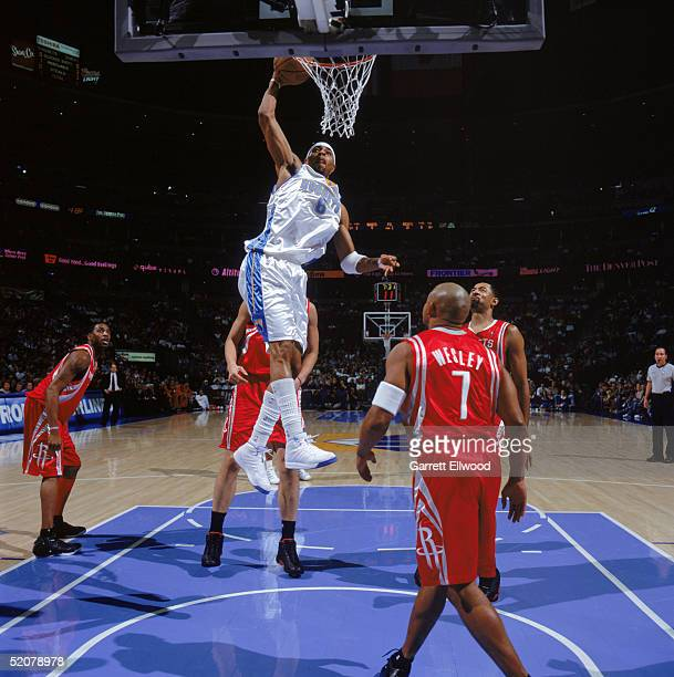 Kenyon Martin of the Denver Nuggets dunks during a game against the Houston Rockets at Pepsi Center on January 9 2005 in Denver Colorado The Rockets...