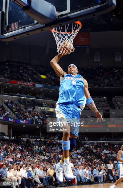 Kenyon Martin of the Denver Nuggets dunks the ball against the Memphis Grizzlies at FedexForum on April 5 2005 in Memphis Tennessee NOTE TO USER User...