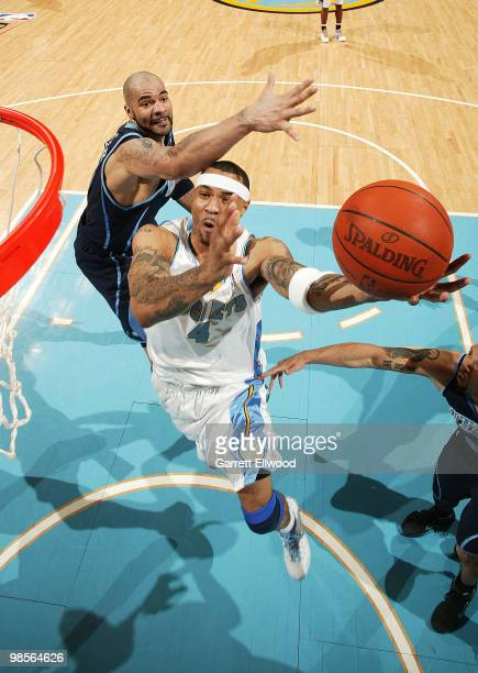 Kenyon Martin of the Denver Nuggets goes to the basket against Carlos Boozer of the Utah Jazz in Game Two of the Western Conference Quarterfinals...