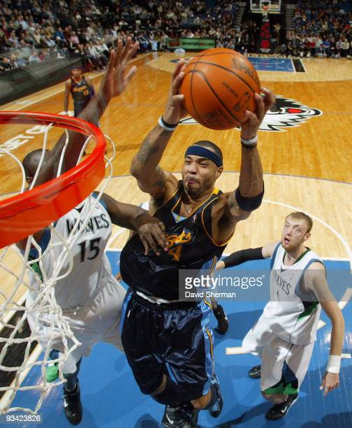 Kenyon Martin of the Denver Nuggets goes to the basket against Nathan Jawai of the Minnesota Timberwolves during the game on November 25 2009 at the...