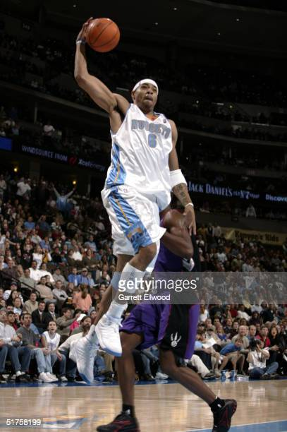Kenyon Martin of the Denver Nuggets goes to the basket against the Toronto Raptors on November 17 2004 at Pepsi Center in Denver Colorado The Nuggets...