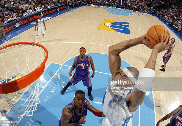Kenyon Martin of the Denver Nuggets goes to the basket against the Phoenix Suns on March 13 2005 at the Pepsi Center in Denver Colorado The Suns...