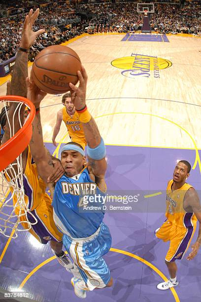 Kenyon Martin of the Denver Nuggets goes up for a dunk against the Los Angeles Lakers at Staples Center on November 21 2008 in Los Angeles California...