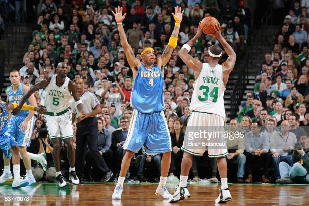 Kenyon Martin of the Denver Nuggets guards the pass by Paul Pierce of the Boston Celtics during the game on November 14 2008 at TD Banknorth Garden...
