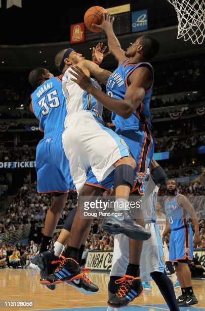 Kenyon Martin of the Denver Nuggets is fouled by Kevin Durant of the Oklahoma City Thunder as Serge Ibaka of the Oklahoma City Thunder helps with...
