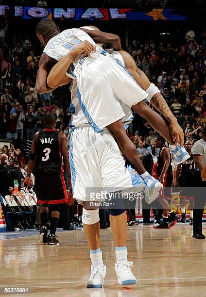 Kenyon Martin of the Denver Nuggets lifts up teammate Earl Boykins after Boykins sunk the gamewinning threepointer against the Miami Heat with 17...