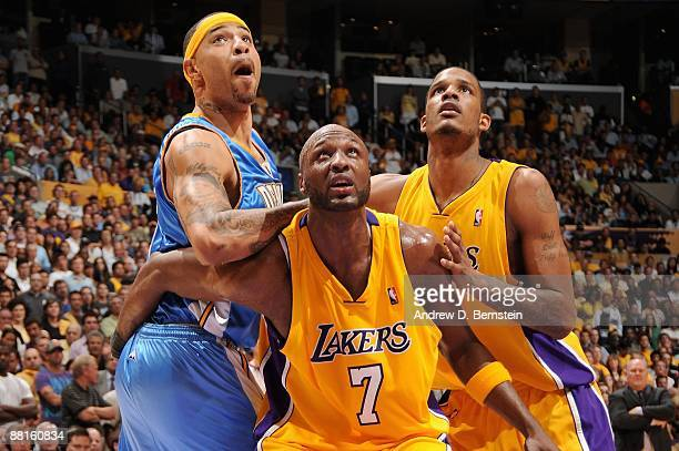 Kenyon Martin of the Denver Nuggets looks for the rebound against Lamar Odom and Trevor Ariza of the Los Angeles Lakers in Game Five of the Western...