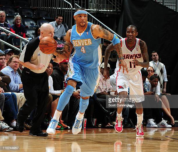 b6633c04a1f Kenyon Martin of the Denver Nuggets passes the ball up court against the  Atlanta Hawks on