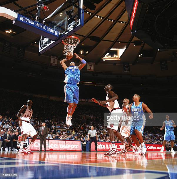 Kenyon Martin of the Denver Nuggets takes the ball to the basket during the game against the New York Knicks at Madison Square Garden on December 12...