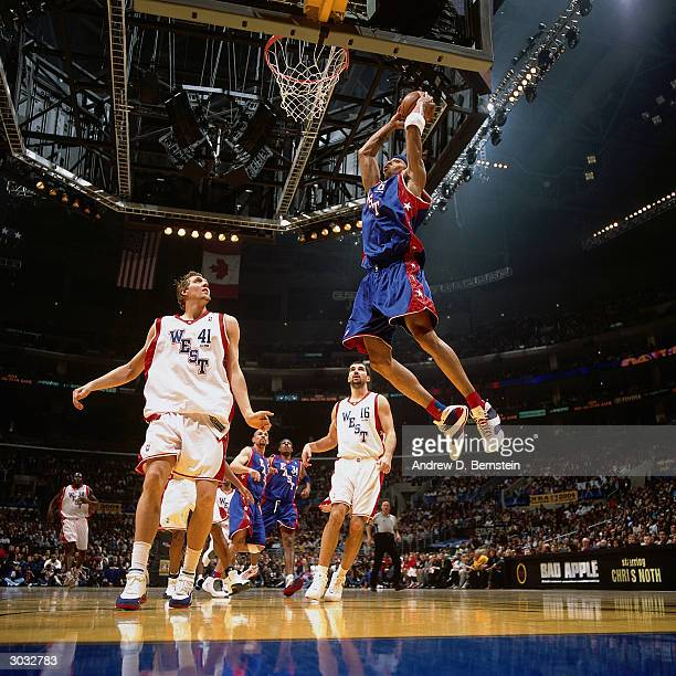 Kenyon Martin of the East AllStars attempts a dunk against the West AllStars during the 2004 NBA AllStar Game at the Staples Center part of the 53rd...