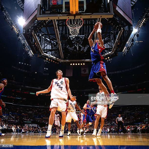 Kenyon Martin of the Eastern Conference AllStars dunks against Dirk Nowitzki of the Western Conference AllStars during the 2004 AllStar Game on...