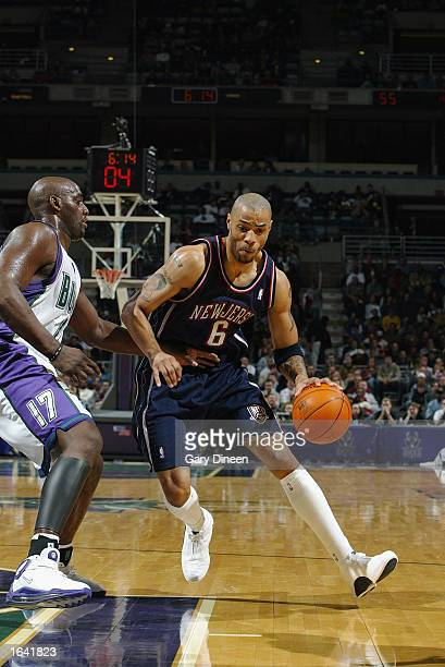 Kenyon Martin of the New Jersey Nets drives past Anthony Mason of the Milwaukee Bucks during the NBA game at the Bradley Center on November 6 2002 in...