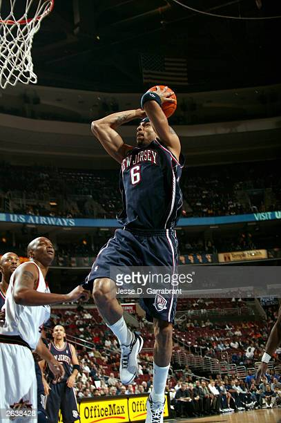 Kenyon Martin of the New Jersey Nets dunks against Derrick Coleman of the Philadelphia 76ers during a NBA pre-season game October 23, 2003 at the...