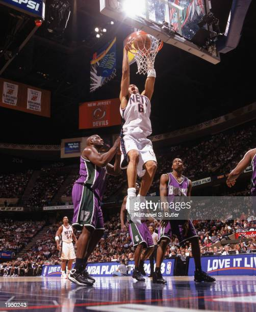 Kenyon Martin of the New Jersey Nets dunks over Anthony Mason of the Milwaukee Bucks during Game One of the Eastern Conference Quarterfinals during...
