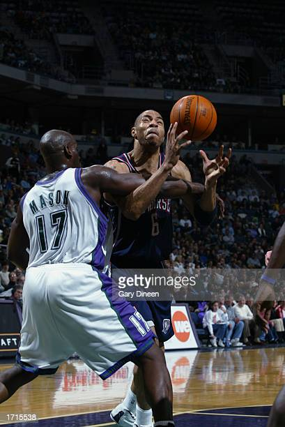 Kenyon Martin of the New Jersey Nets is fouled by Anthony Mason of the Milwaukee Bucks during the game at Bradley Center on December 28 2002 in...