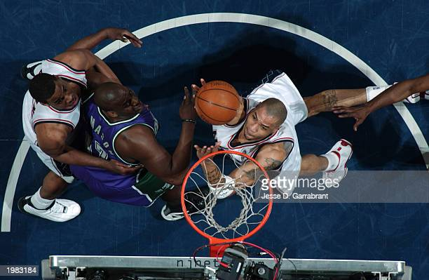 Kenyon Martin of the New Jersey Nets shoots against Anthony Mason of the Milwaukee Bucks in Game five of the Eastern Conference Quarterfinals during...