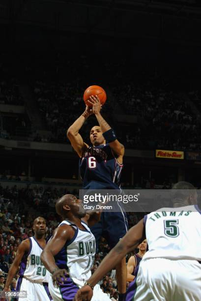 Kenyon Martin of the New Jersey Nets shoots over Anthony Mason of the Milwaukee Bucks in Game four of the Eastern Conference Quarterfinals during the...