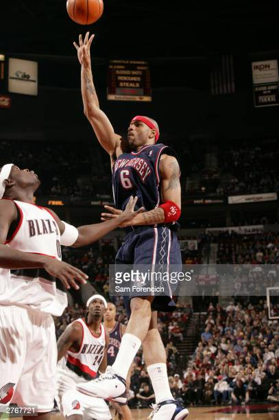 Kenyon Martin of the New Jersey Nets shoots over Zach Randolph of the Portland Trail Blazers during a game on November 28 2003 at the Rose Garden...