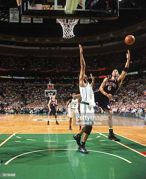 Kenyon Martin of the New Jersey Nets takes the shot against Tony Battie of the Boston Celtics in Game Four of the Eastern Conference Semifinals...