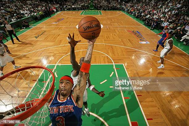 Kenyon Martin of the New York Knicks dunks against Kevin Garnett of the Boston Celtics in Game Six of the Eastern Conference Quarterfinals during the...