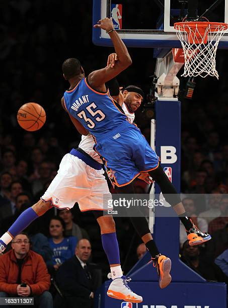 Kenyon Martin of the New York Knicks fouls Kevin Durant of the Oklahoma City Thunder on March 7 2013 at Madison Square Garden in New York City The...