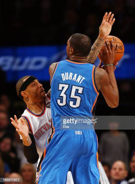 Kenyon Martin of the New York Knicks is called for a foul as he guards Kevin Durant of the Oklahoma City Thunder on March 7 2013 at Madison Square...