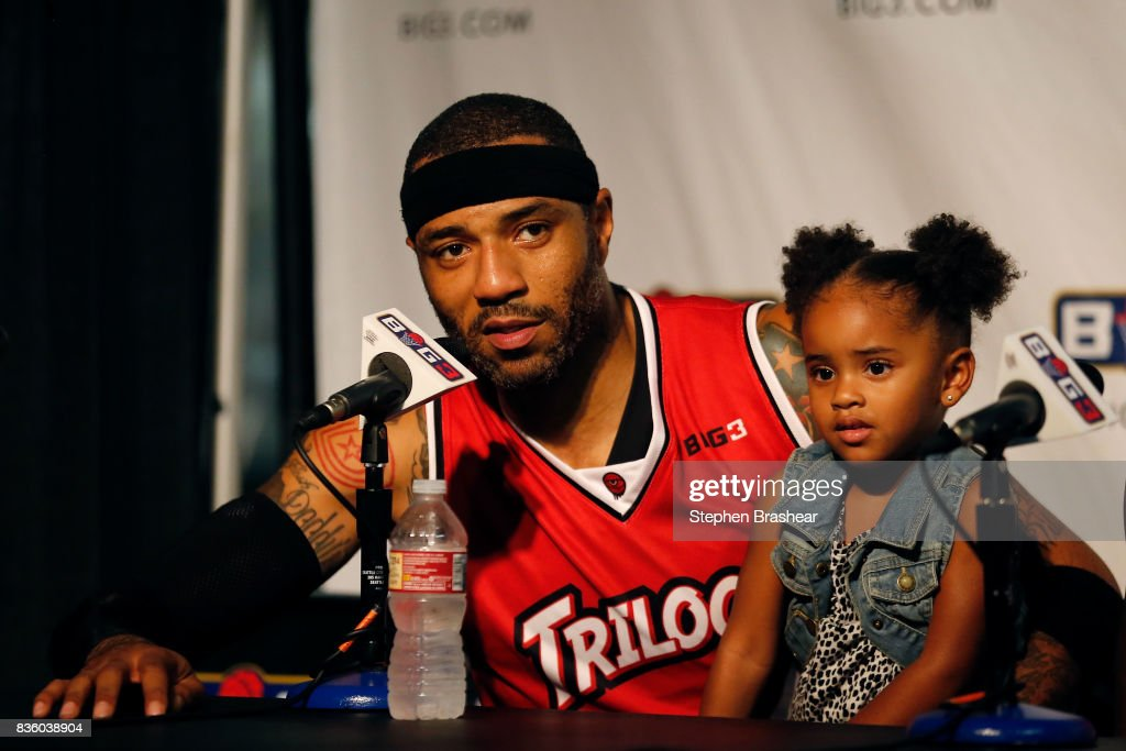 Kenyon Martin #4 of the Trilogy addresses the media with his daughter after winning the semi finals against the Ghost Ballers in week nine of the BIG3 three-on-three basketball league at KeyArena on August 20, 2017 in Seattle, Washington.