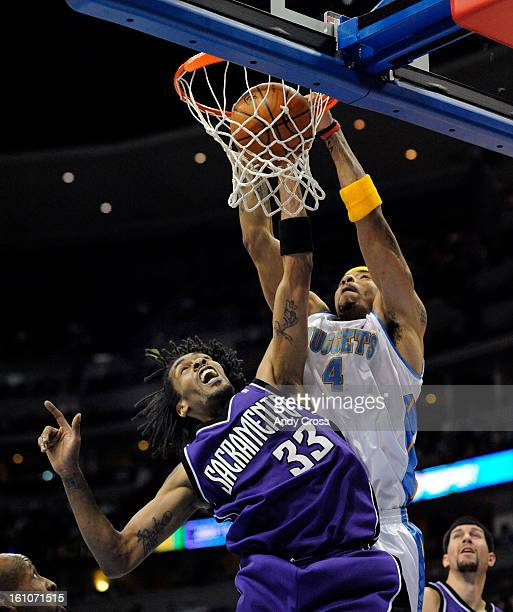 DENVER Kenyon Martin slam dunks against Mikki Moore the Sacramento Kings in the first half of play at Pepsi Center Saturday evening THE DENVER POST/...
