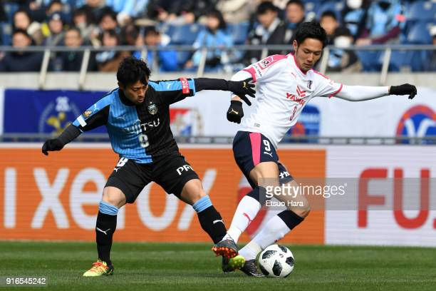 Kenyu Sugimoto of Cerezo Osaka and Hiroyuki Abe of Kawasaki Frontale compete for the ball during the Xerox Super Cup match between Kawasaki Frontale...