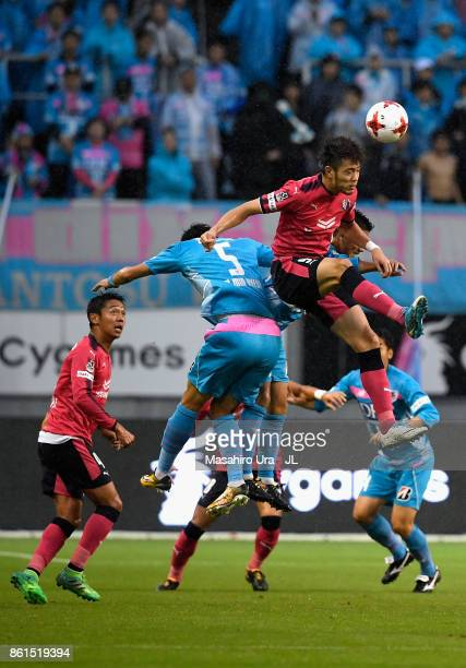 Kenyu Sugimoto of Cerezo Osaka and Kim Min Hyeok of Sagan Tosu compete for the ball during the JLeague J1 match between Sagan Tosu and Cerezo Osaka...
