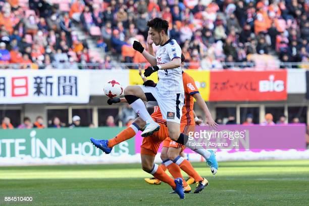 Kenyu Sugimoto of Cerezo Osaka and Seitaro Tomisawa of Albirex Niigata compete for the ball during the JLeague J1 match between Albirex Niigata and...