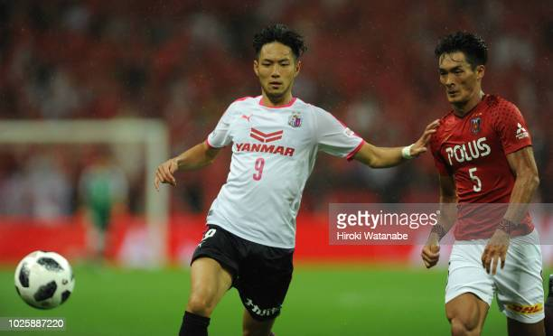Kenyu Sugimoto of Cerezo Osaka and Tomoaki Makino of Urawa Red Diamonds compete for the ball during the JLeague J1 match between Urawa Red Diamonds...