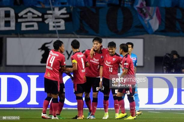 Kenyu Sugimoto of Cerezo Osaka celebrates scoring his side's first goal with his team mates during the JLeague J1 match between Sagan Tosu and Cerezo...