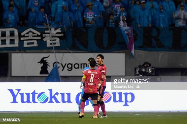 Kenyu Sugimoto of Cerezo Osaka celebrates scoring his side's first goal with his team mate Yoichiro Kakitani during the JLeague J1 match between...