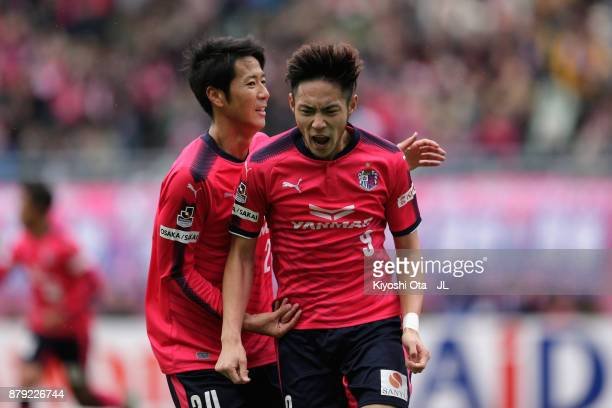 Kenyu Sugimoto of Cerezo Osaka celebrates scoring his side's first goal with his team mate Kazuya Yamamura during the JLeague J1 match between Cerezo...