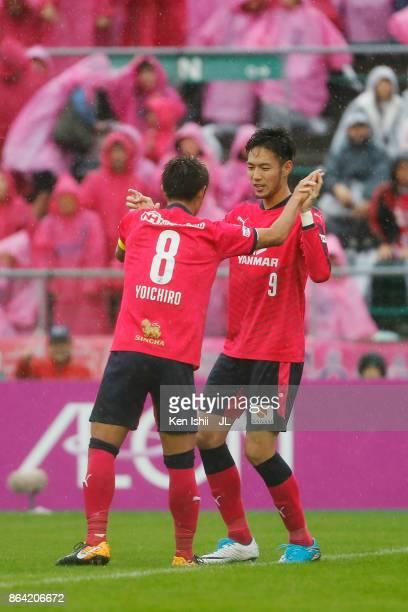Kenyu Sugimoto of Cerezo Osaka celebrates scoring his side's second goal with his team mate Yoichiro Kakitani during the JLeague J1 match between...